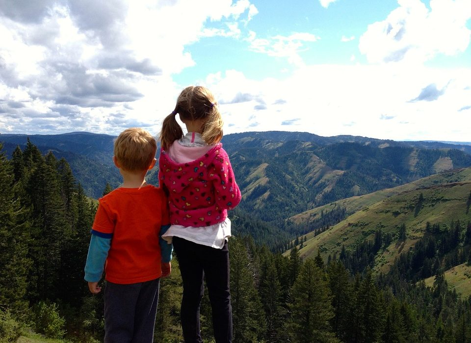 Two children on mountaintop