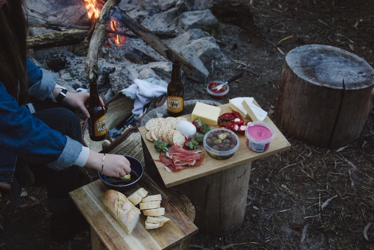 woman having a snack at camp