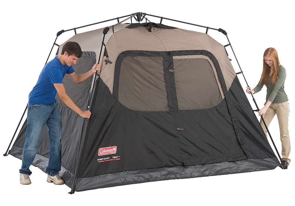 Couple setting up a Coleman tent