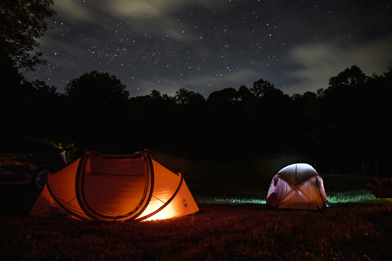 Two tents near a trees